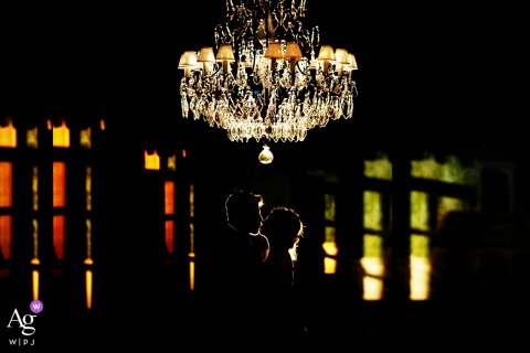 Villa Criscione Modica fine art wedding couple portrait of the newlyweds embracing under a fairytale chandelier