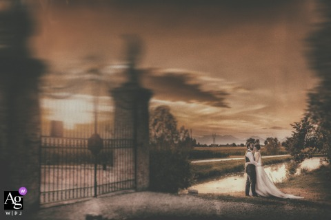 Villa Godi Piovene, Vicenza, Italy fine art wedding couple portrait in warm tones in the countryside