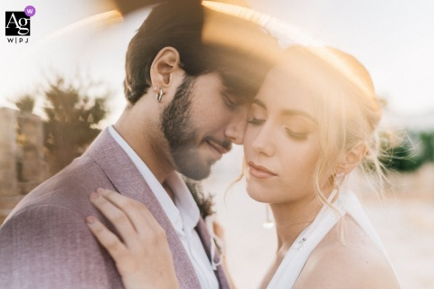 Puglia  creative couple wedding portrait in the sunlight with passion and emotion