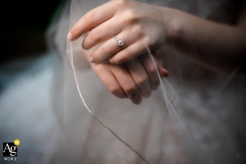 Chicago, llinois fine art wedding detail pic of the brides hands resting under her veil