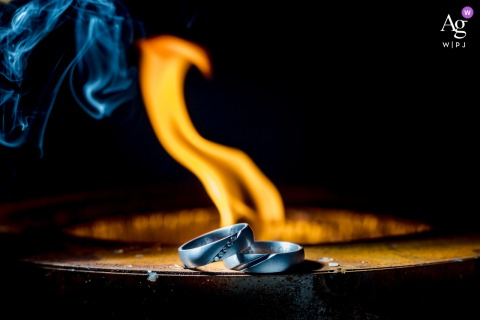 Heuchelberg fine art wedding detail pic of the rings with fire flames and smoke
