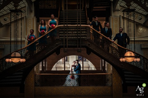 Rookery Building, Chicago bridal party posing for a wedding image on a staircase