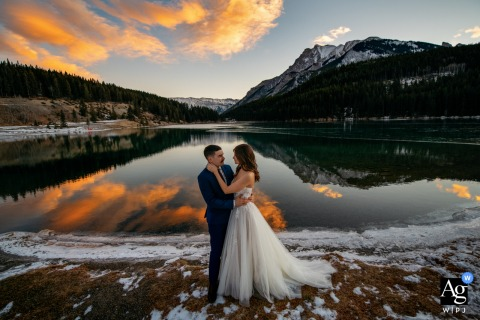 Bow Lake , AB, Canada creative couple wedding portrait with a beautiful sunrise before the ceremony begins