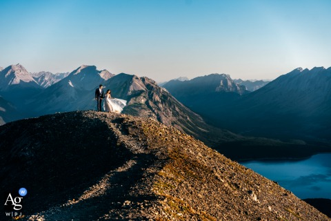 Tent Ridge, Kananaskis, AB, Canada creative wedding day portrait of a beautiful Bride and Groom on the top of the mountain