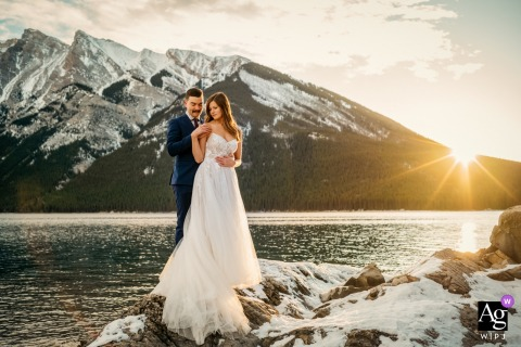 Lake Minnewanka, Banff National Park, AB, Canada fine art wedding portrait of the Bride and groom and a beautiful sunrise