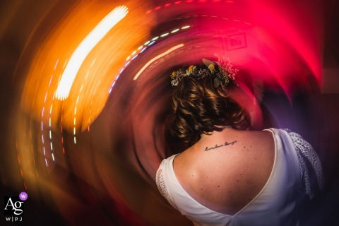 Vernet, France creative wedding detail image using a slow shutter with lights and a tattoo