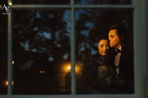 Rust Manor House, Leesburg, VA bride and groom wedding portrait session with a sunbeam through the window