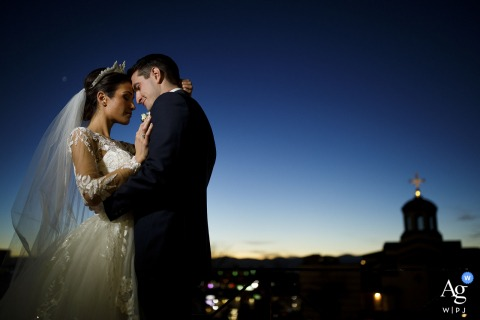 Assumption of the Theotokos Greek Church fine art wedding portrait of a posed couple during twilight moments after their wedding ceremony in Denver, CO