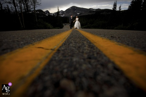 Brainard Lake, Ward, CO fine art wedding couple posed together on the road leading to Brainard lake following their elopement