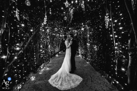Villa Aurelia Roma fine art wedding couple portrait surrounded by lights in black and white