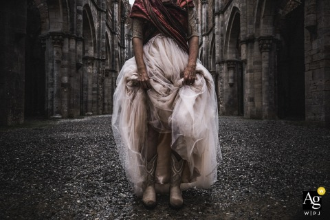 San Galgano Abbey, Tuscany fine art wedding detail pic of the alternative bride in dirt and mud