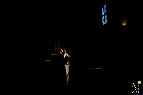Lombardy couple posing for wedding images lit by window light