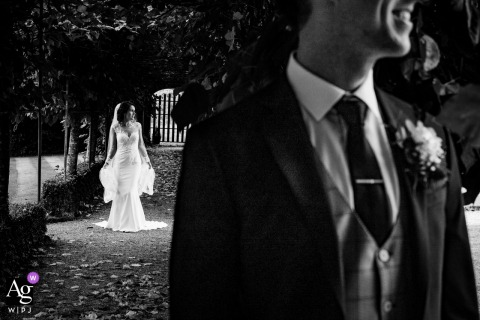 Ashford Castle fine art wedding Couple in creative pose in black and white outside