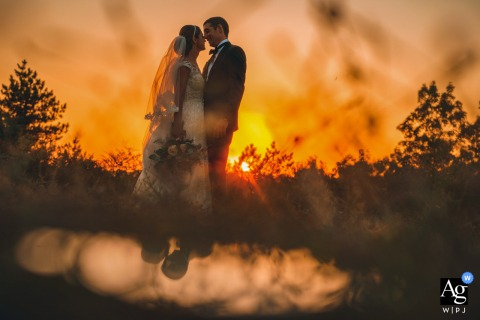 Bulgaria, Veliko Tarnovo, Raya Garden creative orange sunset wedding pic with the Bride and groom