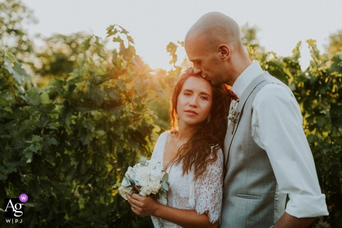 Esterra Vini Bulgaria soft sunlit wedding couple photo from A sunny minute in the vineyards