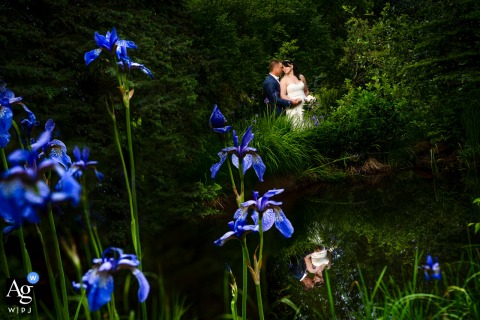 Romantic Riversong Inn, Estes Park, CO creative nature wedding portrait session near a pond