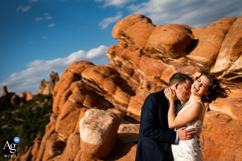 Garden of the Gods Park - Colorado Springs, Colorado couple embracing during portraits on their wedding day.