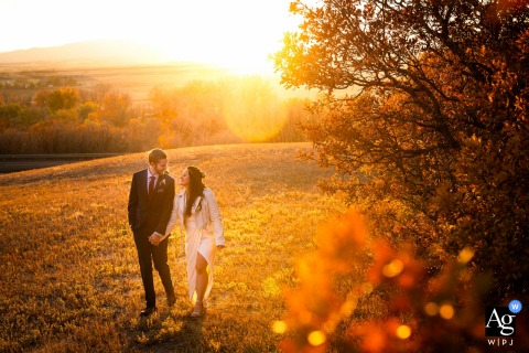 Wedding photography from Sedalia, CO as the couple walks together during portraits on their wedding day
