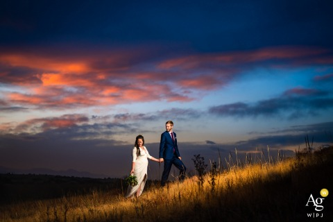 Sedalia, CO bride and groom pose for sunset portraits on their wedding day
