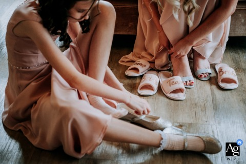 UK wedding reportage photograph from the Getting ready address in Yorkshire of The bridal party getting their shoes on
