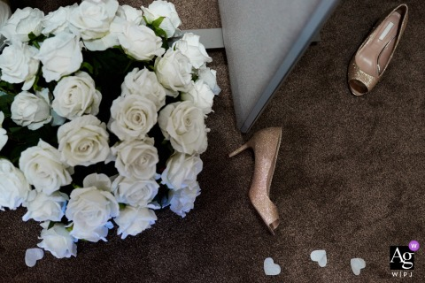 Creative detail wedding photo from a Private venue, Birmingham, UK	of Wedding shoes on the floor