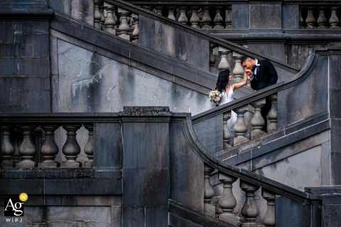 DE artistic wedding photo from the Winterthur Museum and Country Estate, Wilmington during A cinderella moment on the grand garden staircase
