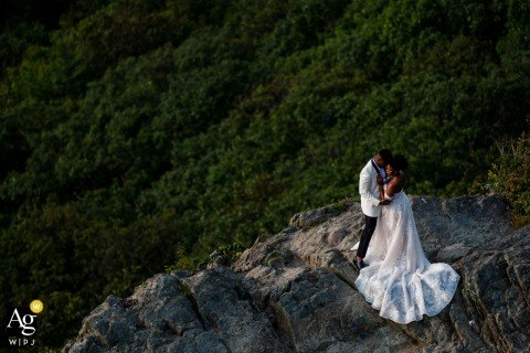 Little Stoneyman, Shenandoah National Park image of The couple embracing at the edge of a cliff in a some creative wedding photography