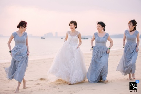 Sanya, China wedding bridal party artistic portrait session of the bride and her bridesmaids on the beach