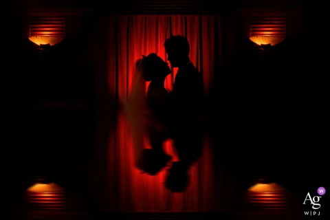 Xi'an, Shaanxi, China wedding couple artistic image session of the silhouetted couple in red tones