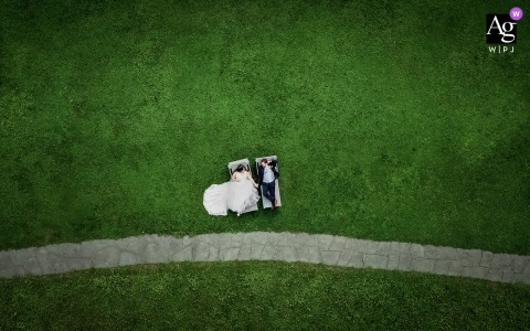 Switzerland wedding couple artistic image session of the couple on a grass field