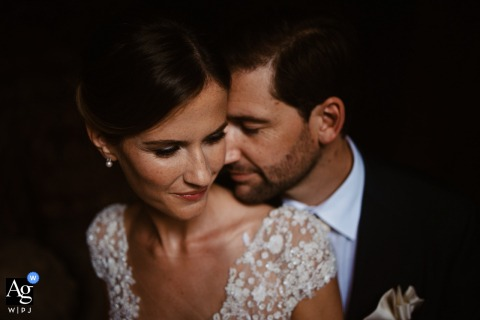 Church of Saints Cyricus and Julitta wedding couple artistic image session in a spotlight at sunset, the intimacy of the bride and groom is shown by the way the groom leans into the bride