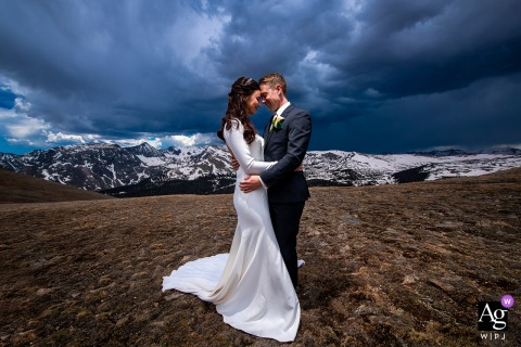 Rocky Mountain National Park, Estes Park, CO wedding couple artistic image session of the bride and groom on top of Continental Divide