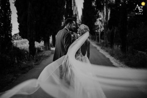 Linari Agriturismo, Siena wedding couple artistic image session of the brides veil taking up the shot