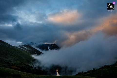 Colorado wedding couple artistic image session of the couple surrounded by mountains and fog