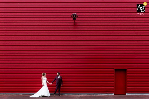 Albi, France wedding couple artistic image session of the couple posing in front of a red wall