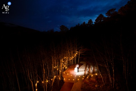 Wild Basin Lodge, Allenspark, Colorado wedding venue outdoor reception photography of the newlyweds sharing a last dance of the night on the back patio