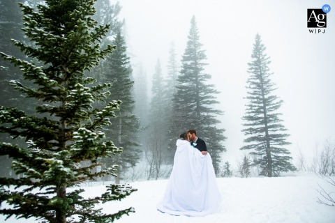 Bear Lake, Rocky Mountain National Park, Colorado wedding couple artistic image session of fog surrounding the couple at their elopement