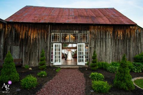 The Adirondacks, New York wedding venue reception photography - the swing dancing couple having a blast on the dancefloor inside the historic barn