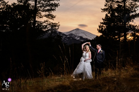 Estes Park, CO wedding couple artistic image session of the couple sharing a sunset dance before the end of their wedding celebration