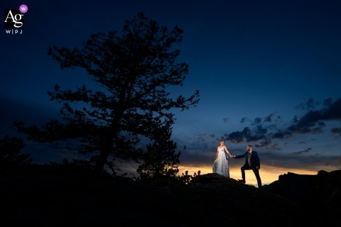 Estes Park, CO wedding couple artistic image session of the newlyweds sharing a walk at sunset
