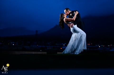 Estes Park, CO wedding couple artistic image session of a newlywed couple shares a romantic embrace at sunset