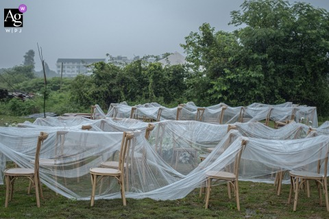 Zhejiang artful style wedding detail picture of the ceremony chairs covered to protect from the rain