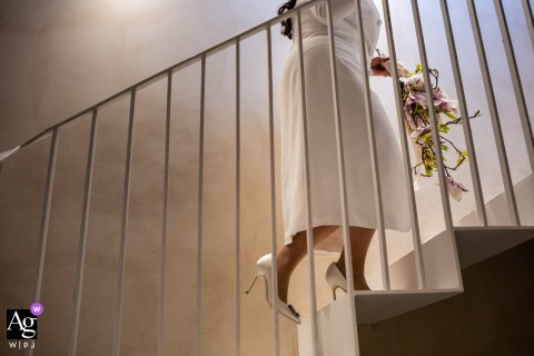 Lucca artful style wedding detail picture of the the bride walking up the stairs