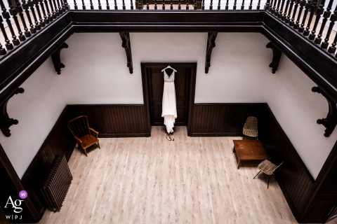 Chateau du Vergnet, Tarn, France wedding venue indoor photograph of the wedding dress and shoes positioning in the main castle room
