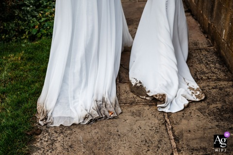 Rudding Park Hotel, Harrogate, UK artful style wedding detail picture of bride's dresses got dirty over the day