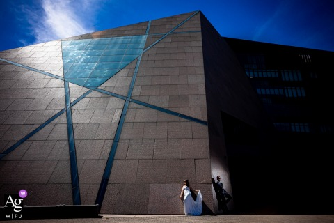 McNamara Event center, Minneapolis, MN wedding couple artistic image showing the Bride and groom are chill outside of the venue