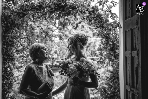San Demetrio Church, Cesena, Italy wedding artistic image showing the bride with her mum, before entering the church, in a very intimate moment