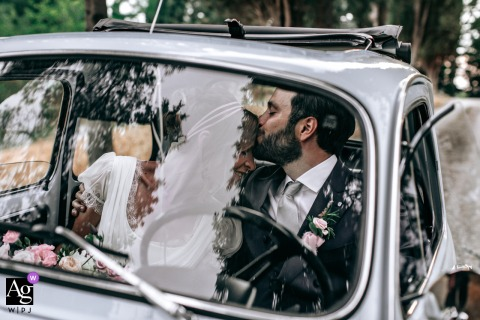 San Demetrio Church area, Cesena, Italy wedding couple artistic image session with the bride and groom, just married, in their renewed old vintage grandpa italian car Cinquecento