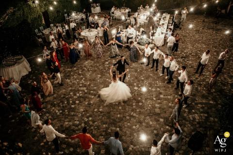 Palazzo Marcosanti, Poggio Berni, Rimini, Italy wedding venue outdoor reception photography showing the wedding dance from the top floor