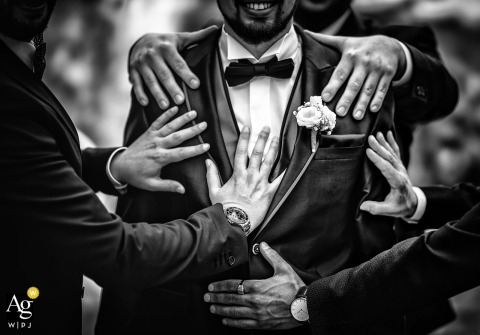 Ovada Torino artful style wedding detail picture in BW with grooms mens hands on grooms tux